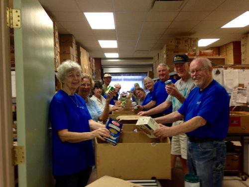 Volunteers packing boxes