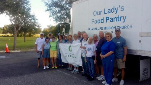 Volunteers by truck accepting donation