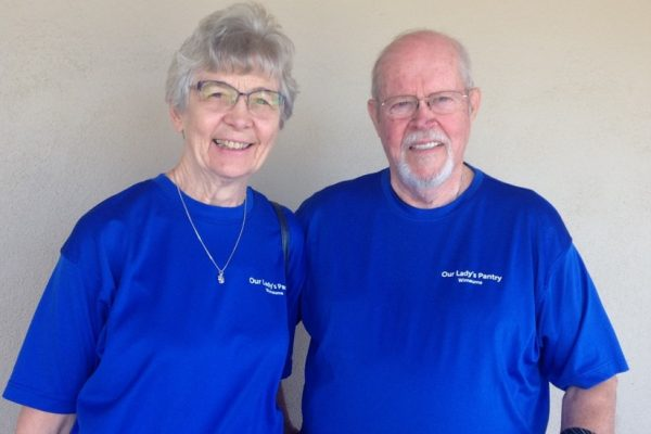 Woman and man in blue pantry shirts