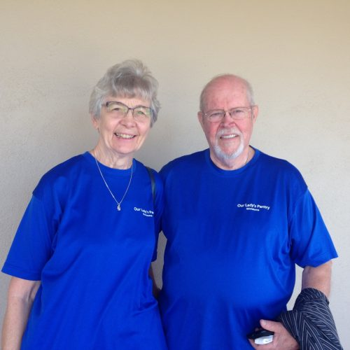 Man and woman in blue Pantry shirts