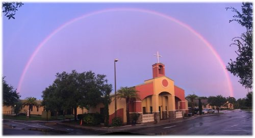 Church with rainbow overhead