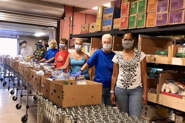 Pantry workers wearing masks